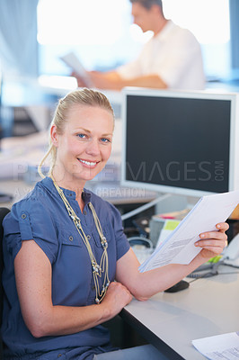 Buy stock photo Cropped shot of a businesswoman working in the office with her colleague in the background
