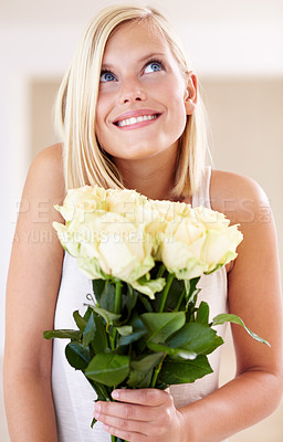 Buy stock photo A young woman holding a bunch of roses