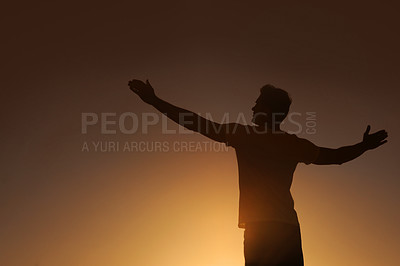 Buy stock photo Silhouette of a man with his arms outstretched - copyspace