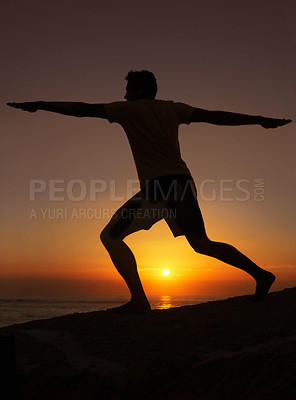Buy stock photo Silhouette of a man exercising with the sunset in the background