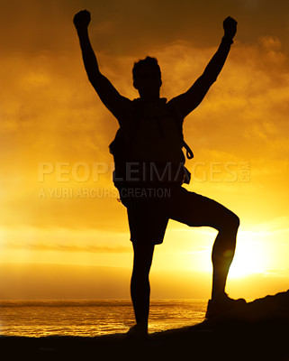 Buy stock photo Silhouette of a hiker standing on a mountain with his arms raised