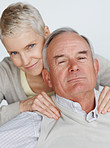 Senior man getting a shoulder massage from wife