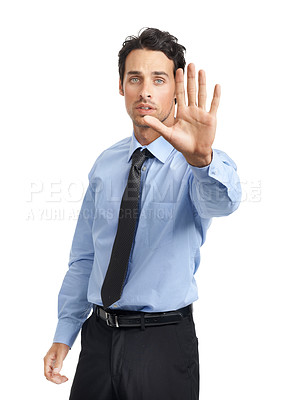 Buy stock photo Studio shot of a young businessman showing a stop gesture
