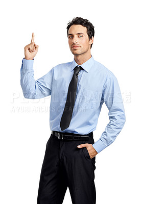Buy stock photo Studio shot of a handsome businessman pointing up at copyspace