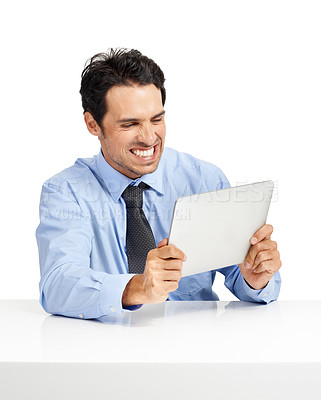 Buy stock photo Studio shot of a handsome businessman using a tablet