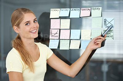 Buy stock photo Cropped shot of a young female designer working in the office