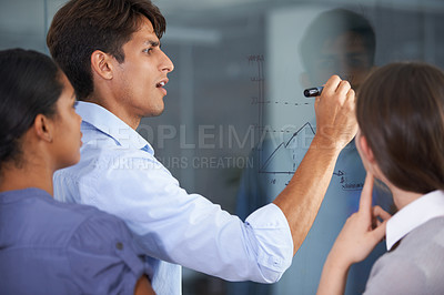 Buy stock photo Cropped shot of three young colleagues at