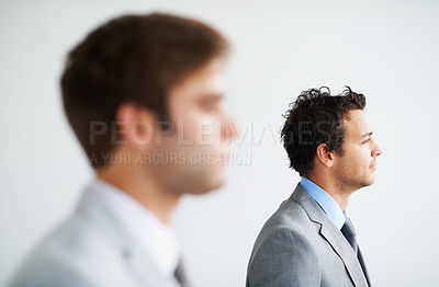 Buy stock photo Profile of two businessmen looking away thoughtfully - Focus on background