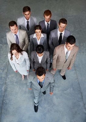 Buy stock photo Top view of a group of young businesspeople walking forward looking determined and serious