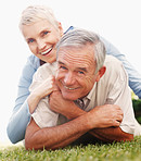 Happy elderly woman on husband's back