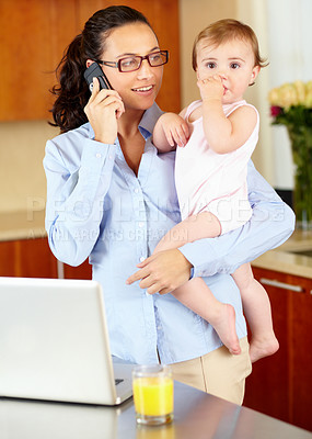 Buy stock photo Shot of a happy-looking single mom talking on the phone while cradling her baby