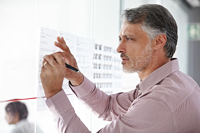 Buy stock photo A mature businessman planning his next move