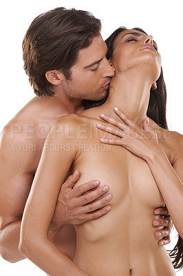 Buy stock photo Shot of a naked couple enjoying a sensual moment against a white background