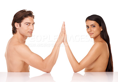 Buy stock photo Studio shot of a gorgeous nude couple sitting opposite each other with their palms together