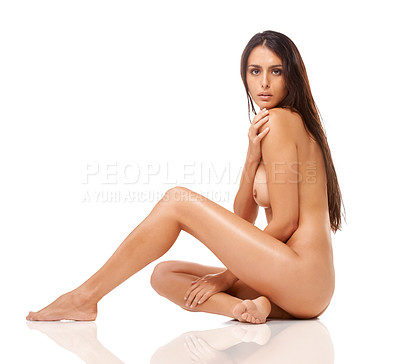 Buy stock photo Studio shot of a gorgeous naked woman posing seductively against a white background