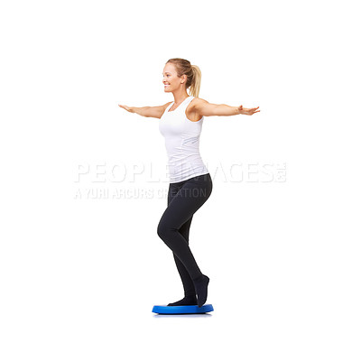 Buy stock photo Full length studio shot of an attractive woman doing balance exercises isolated on white
