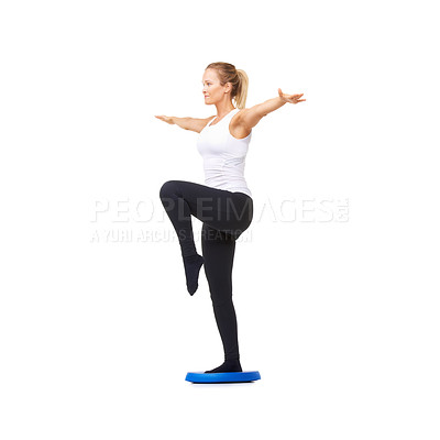 Buy stock photo Full length studio shot of a beautiful young woman doing balance exercises isolated on white