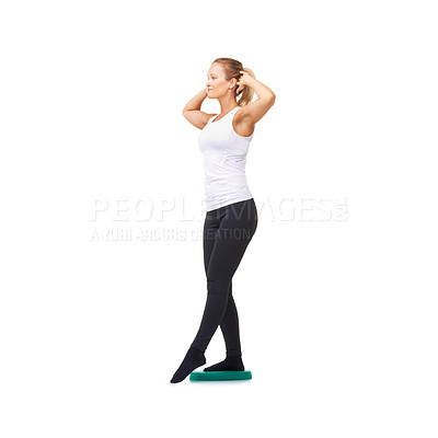 Buy stock photo Full length studio shot of a young woman doing balance exercises isolated on white