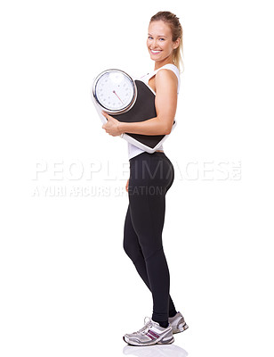 Buy stock photo Studio portrait of a sporty woman holding a scale and  smiling at the camera isolated on white