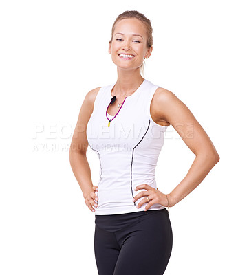 Buy stock photo Portrait of an attractive young woman standing with her hands on her hips