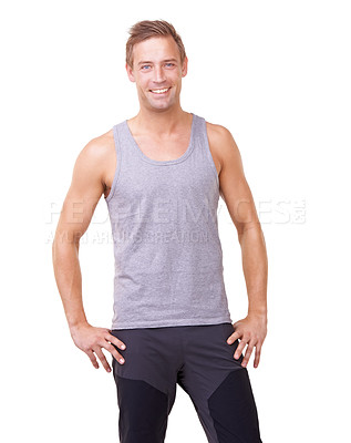 Buy stock photo Portrait of a handsome young standing with his hands on his hips