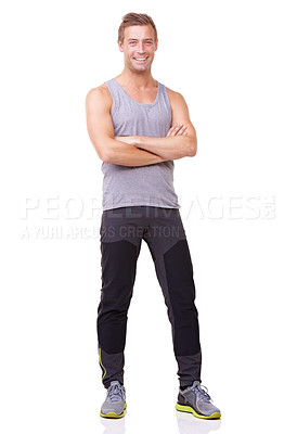 Buy stock photo Full length studio portrait of a fit young man standing with his arms crossed isolated on white
