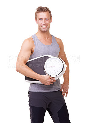 Buy stock photo Studio portrait of a fit young man holding a scale and smiling at the camera isolated on white