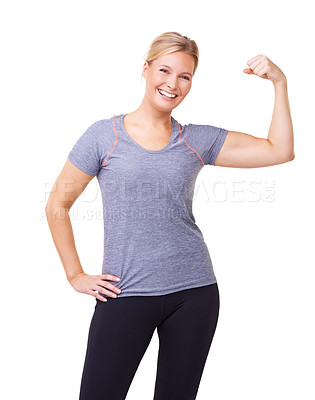 Buy stock photo Studio portrait of an attractive and sporty woman flexing her muscles and smiling at the camera isolated on white