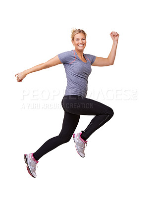 Buy stock photo Studio shot of a beautiful young woman leaping through the air across the frame isolated on white