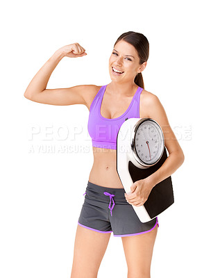 Buy stock photo Studio portrait of a happy young woman flexing one arm and carrying a scale isolated on white