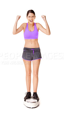 Buy stock photo Full length shot of an ecstatic young woman weighing herself on a scale isolated on white