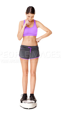 Buy stock photo Full length shot of an attractive young woman weighing herself on a scale isolated on white