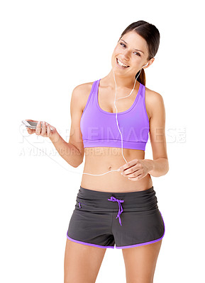 Buy stock photo Portrait of a sporty young women listing to music on an mp3 player isolated on white