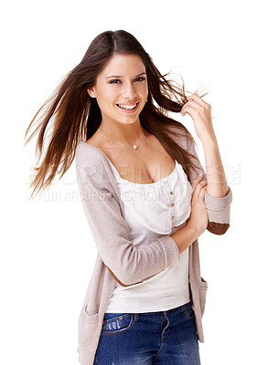 Buy stock photo Studio shot of a beautiful young woman twirling her hair against a white background