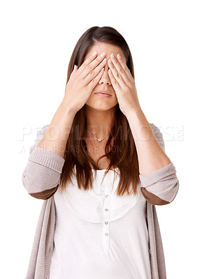 Buy stock photo Casually dressed young woman with her hands covering her eyes