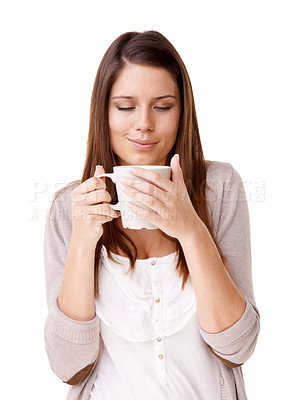 Buy stock photo Casually dressed young woman drinking a cup of coffee against a white background