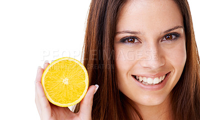 Buy stock photo Portrait of a beautiful brunette woman holding up half of an orange