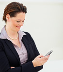 Happy business woman reading an SMS