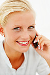 Closeup portrait of a lovely blond speaking on  cellphone