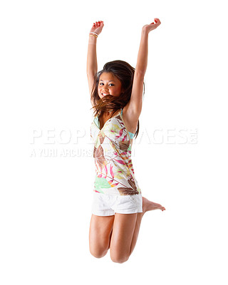 Buy stock photo One very happy energetic cute woman jumping into the air. Hooray!