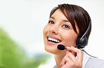Female call centre employee speaking on  headset