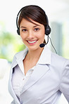 Cute young female call centre employee smiling