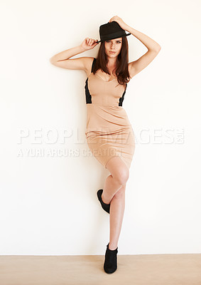Buy stock photo A young attractive woman posing against a white background