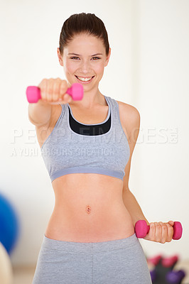 Buy stock photo Portrait of a beautiful young woman training with a dumbbell in the gym