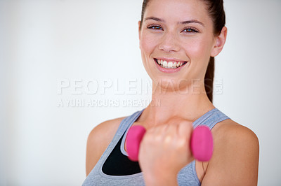 Buy stock photo Portrait of a happy young woman doing bicep curls with weights