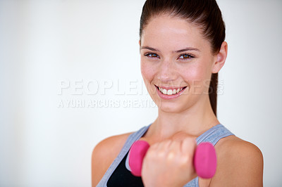 Buy stock photo Portrait of an attractive young woman doing bicep curls with weights
