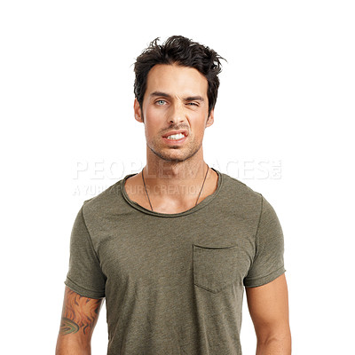 Buy stock photo A handsome young man pulling a face