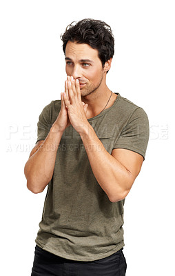 Buy stock photo A handsome young man standing with his hands together in a hopeful gesture