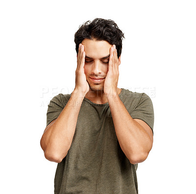 Buy stock photo A handsome young man holding his head in shame