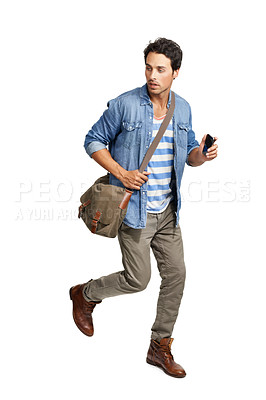 Buy stock photo A handsome young man running against a white background